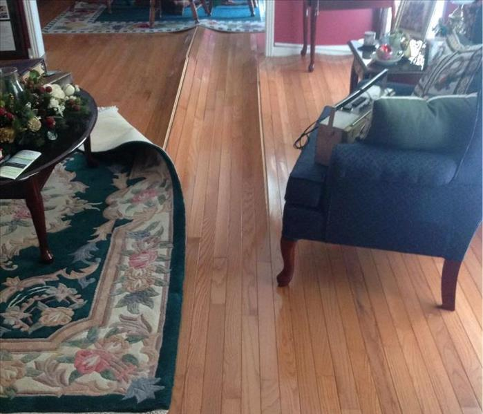 Water Damage to Hard Wood Floors  Before